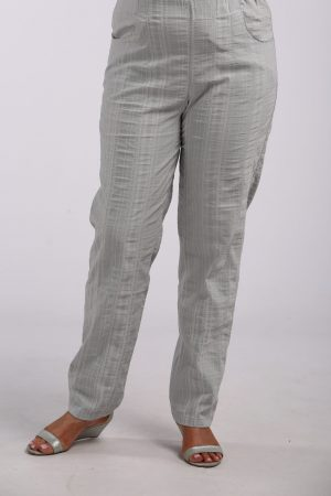 Woman wearing summer cool trousers in silver grey by K J Brand