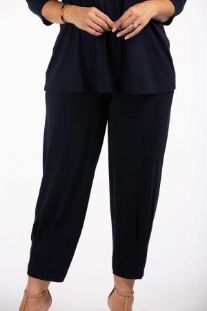 Woman seen wearing navy jersey harem trousers by Q'Neel