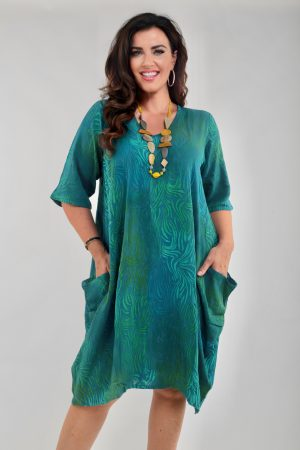 Lady wearing Angel Circle dress in teal