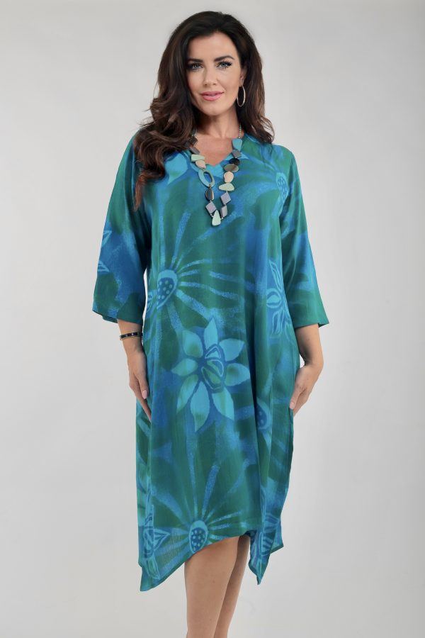 Woman wearing 3/4 sleeve dress by Angel Circle in turquoise