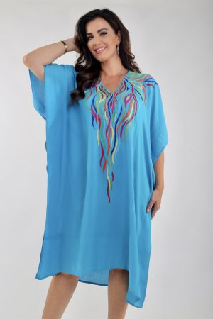 Lady wearing turquoise Angel Circle kaftan embroidery