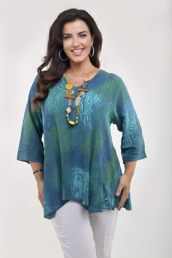 Woman wearing teal viscose top from Angel Cricle