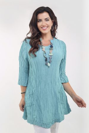 Model is wearing an aqua colour silk/linen 2 pocket tunic designed by Grizas