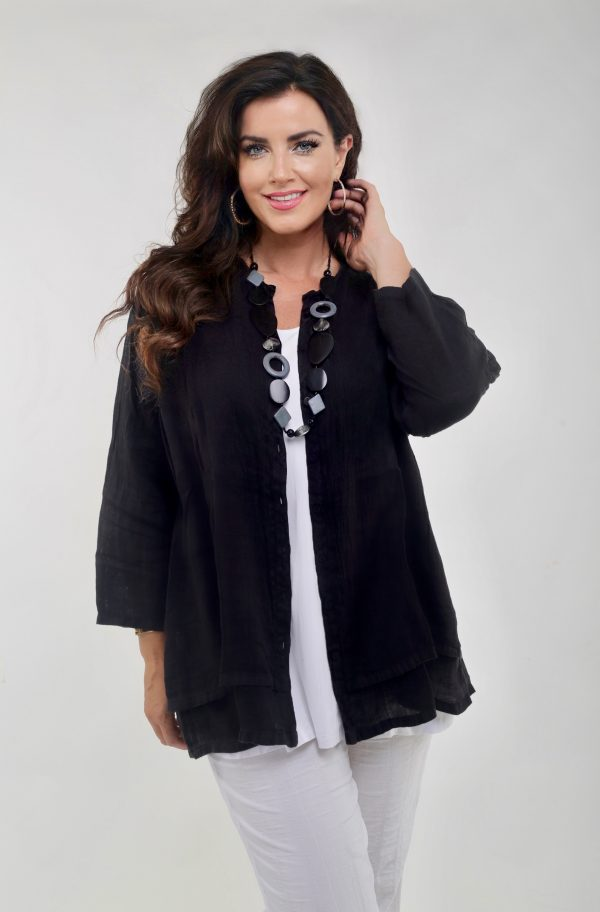 Lady wearing linen grandad shirt in black made by Grizas
