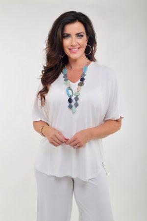 Woman wearing batwing jersey tee shirt in cream by Q'Neel