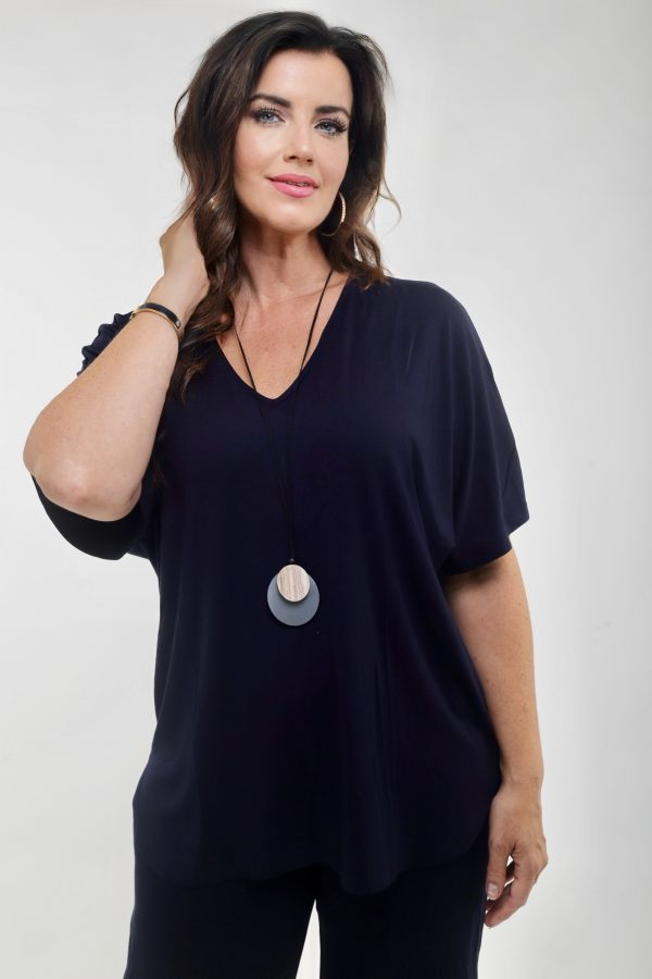 Woman wearing a navy tee shirt by Q'Neel