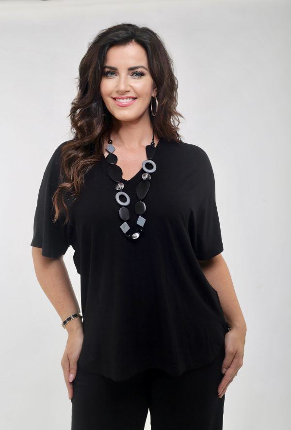 Lady wearing black batwing jersey tee shirt by Q'Neel