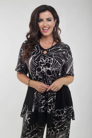 Womane is wearing print tunic in black by See You