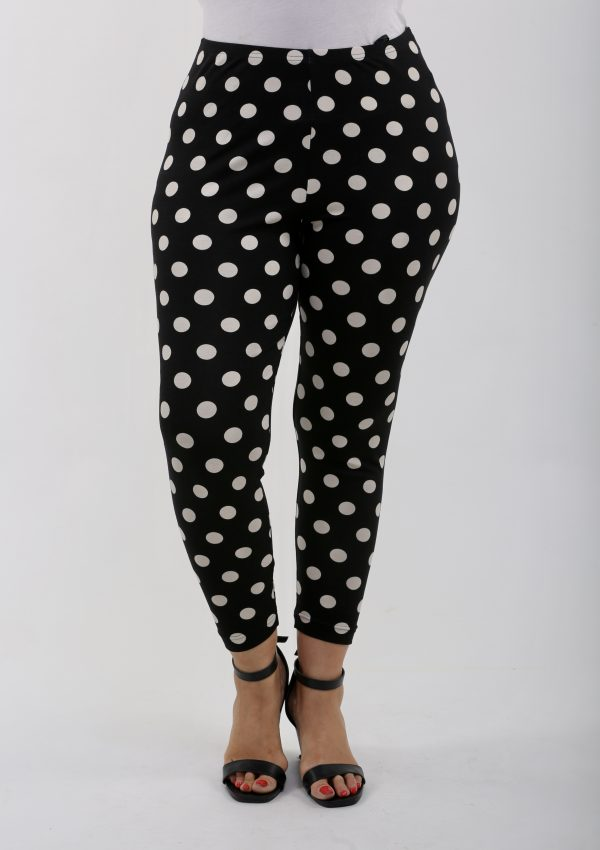 Model is wearing black/cream spot leggings by Verpass