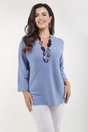 Lady wearing sky blue cotton jumper by Via Appia