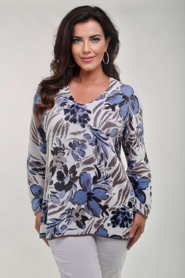 Model wearing pretty floral cotton jumper from Via Appia