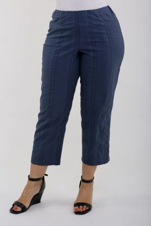 Woman wearing denim summer crops by KJ Brand
