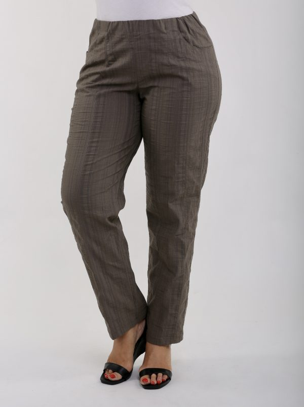 lady is wearing cool summer khaki trousers by KJ Brand
