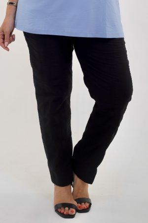 Woman wearing KJ Brand wash & Go stretch trousers in black