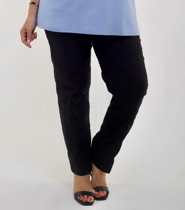 Woman wearing KJ Brand wash & Go stretch trousers in black