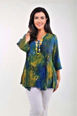 Model is wearing V neck pocket top in blue/yellow by Angel Circle