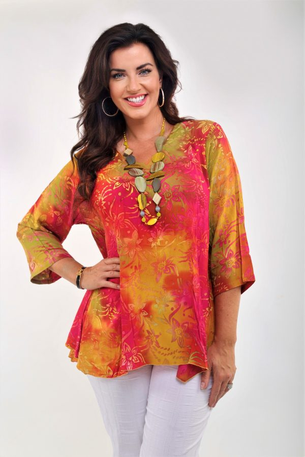 Woman is wearing V neck pocket top in citrus colours by Angel Circle
