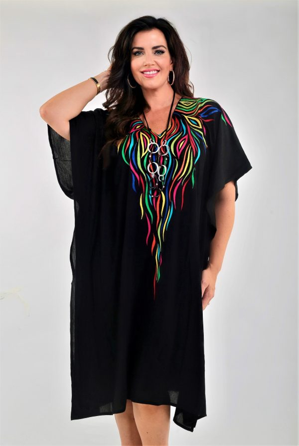 Woman wearing black embroidered kaftan by Angel Circle