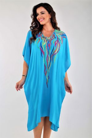 Model is wearing turquoise embroidered kaftan by Angel Circle