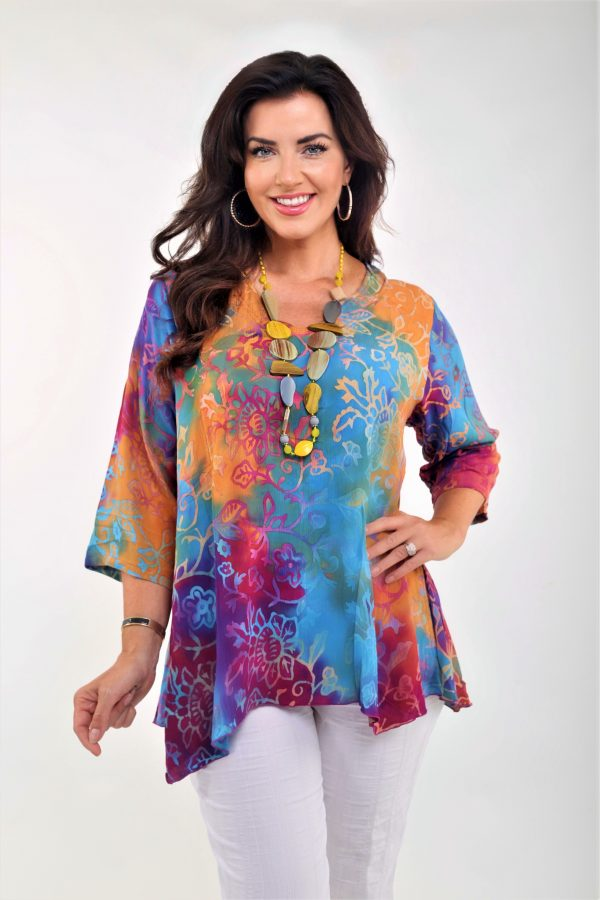 Woman is wearing Angel Circle V neck pocket top in a multicoloured fabric