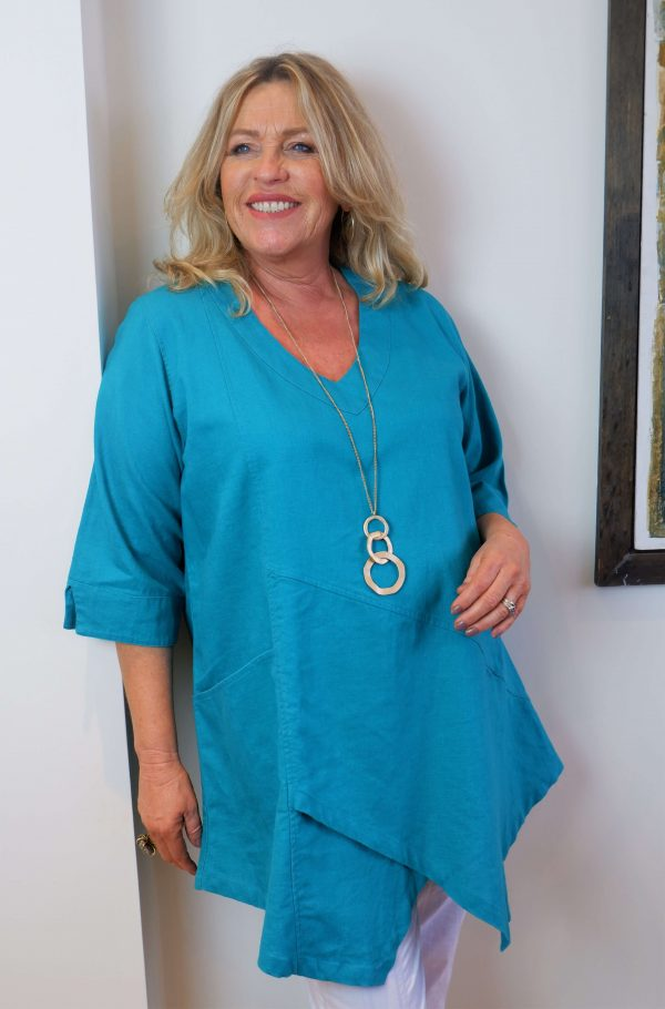 Woman wearing aqua linen top called Tessie by Kasbah Clothing