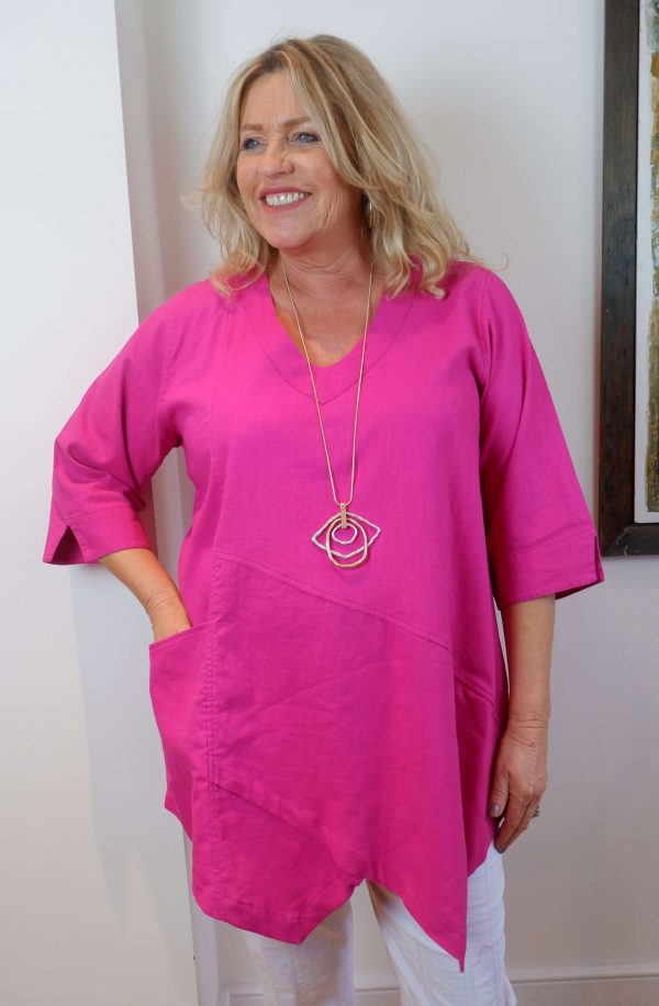 Lady wearing Kasbah Clothing Tessie 100% linen top in fuchsia