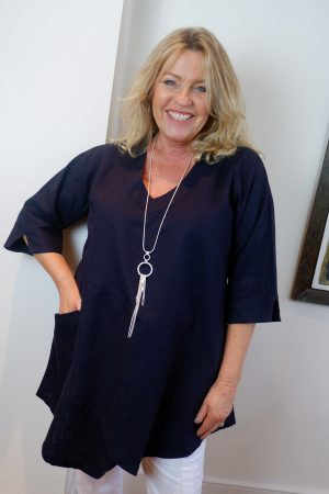Lady wearing Tessie linen V neck top in Navy by Kasbah Clothing