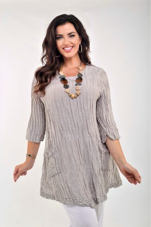 Woman wearing capuccino coloured silk linen tunic by Grizas