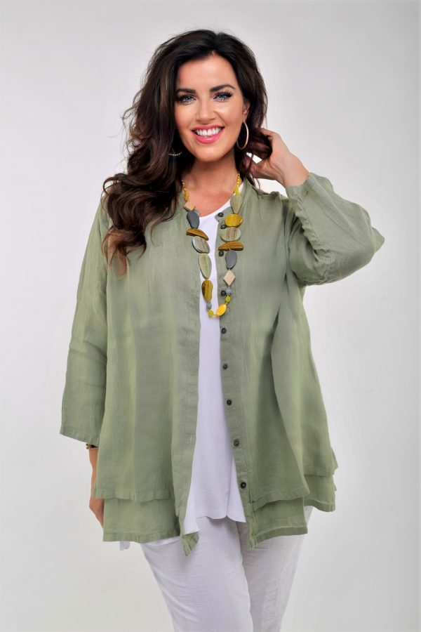 Model is wearing olive linen shirt with grandad collar designed by Grizas