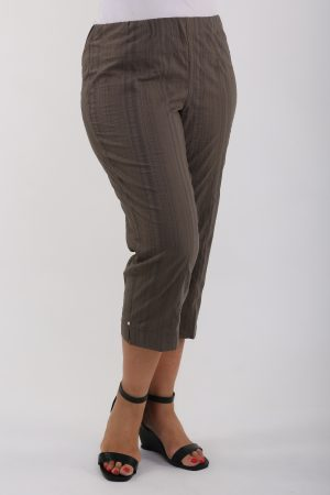 Woman wearing stretch pedal pushers in Wash & Go fabric by KJ Brand in colour Khaki