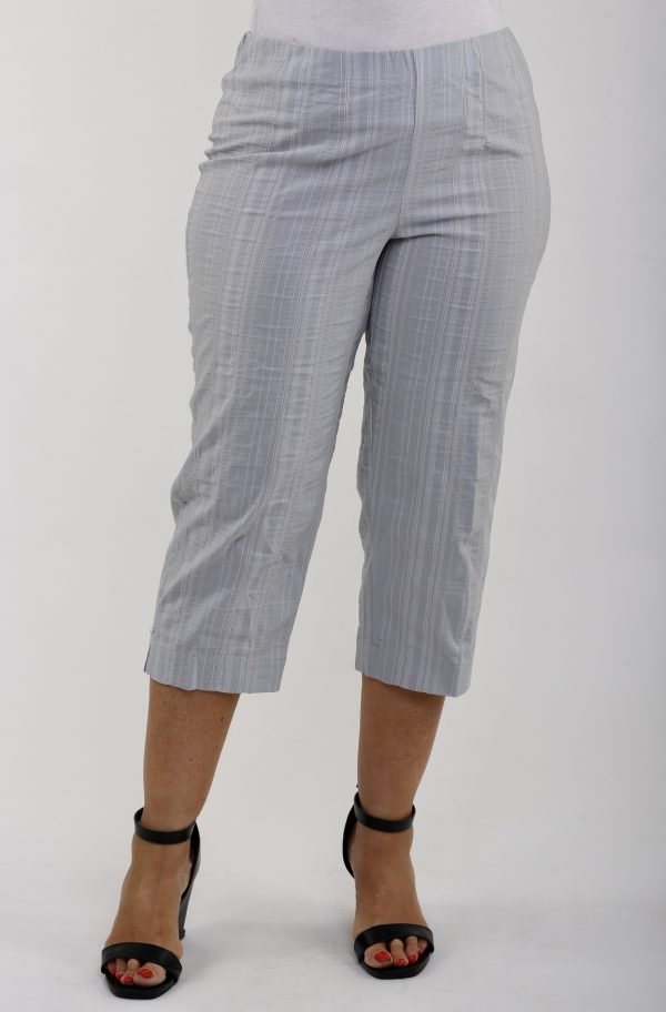 Woman wearing KJ Brand Wash & Go stretch pedal pushers in silver grey