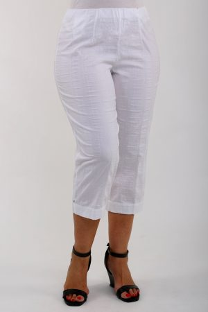 Woman wearing white KJ Brand Wash & Go pedal pushers