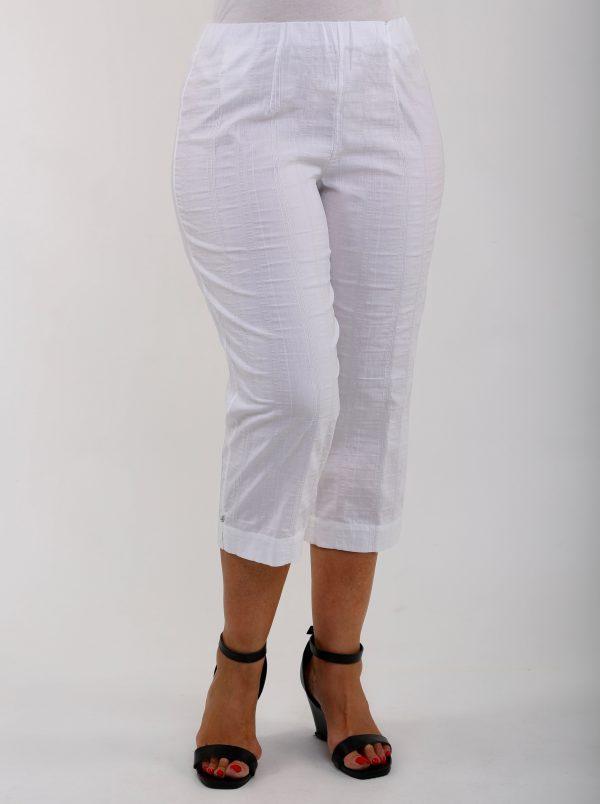 Woman wearing white KJ Brand Wash & Go pedal pushers