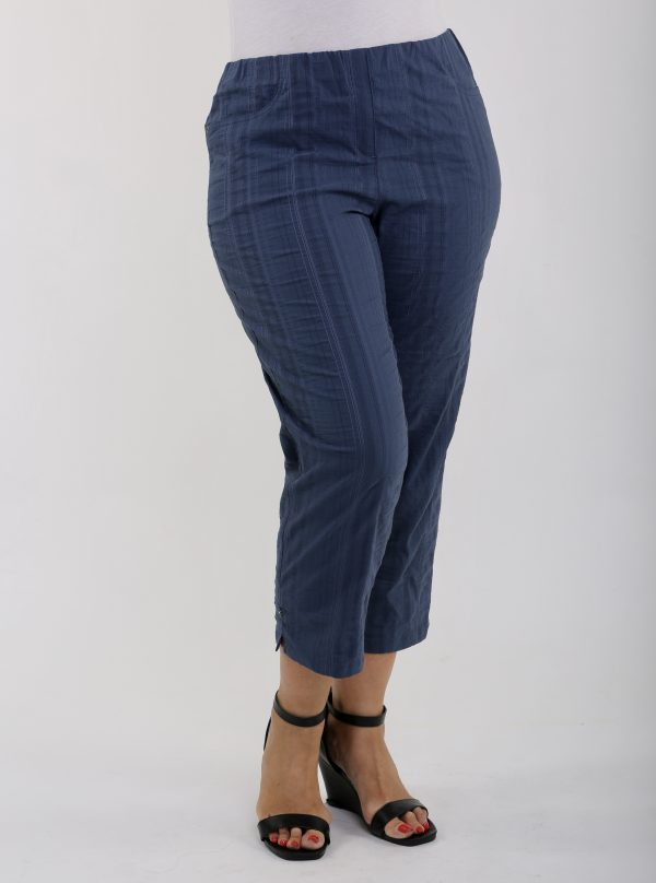 Woman wearing KJ Brand Wash & Go stretch pedal pushers in Denim