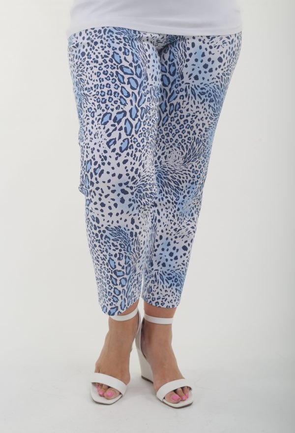 Woman wearing animal print stretch crop trousers in blue and white by Robell