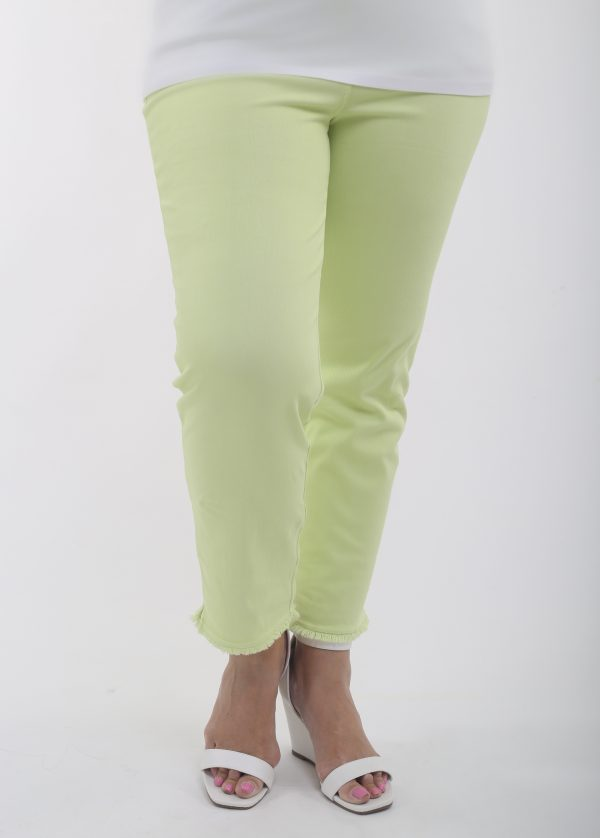Woman wearing lime stretch jeans by Biggi M See You