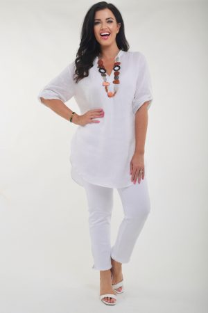 Woman wearing extremely stretchy knit jeans in white by See You Biggi M