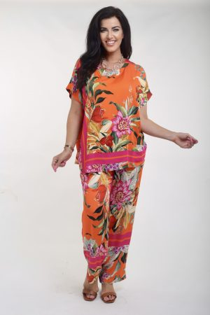 Woman wearing floral top and palazzos by Q'Neel