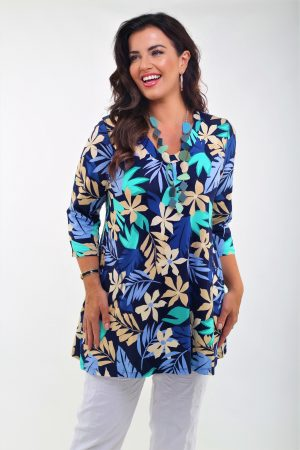 Woman is wearing a jersey floral tunic called Melina by Pont Neuf Pardon Clothing