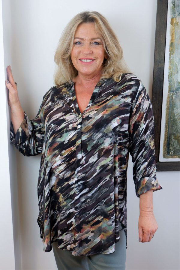 Woman wearing camouflage top called Targa Kaftan by Kasbah Clothing