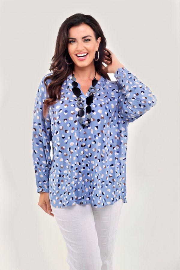 Model wearing spot blouse in sky blue by Via Appia
