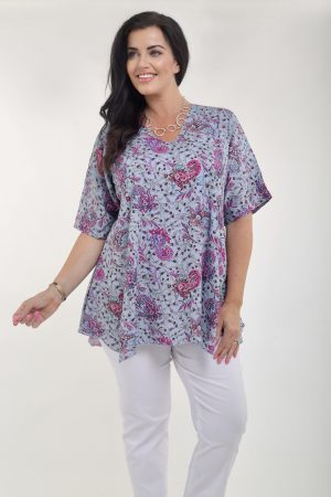 Model is wearing ANgel Circle paisley V neck top in blue