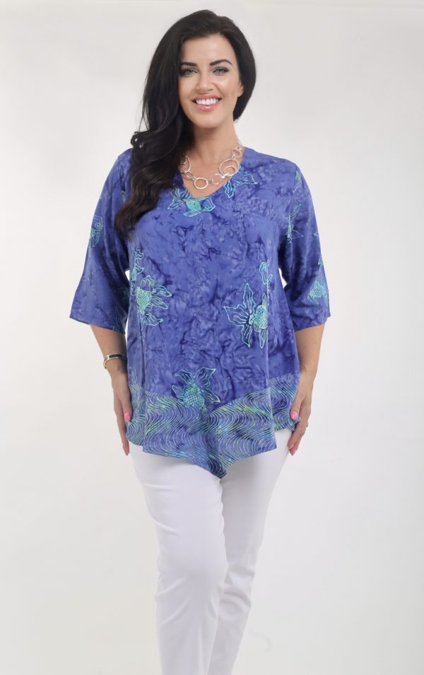Model is wearing a V neck viscose top in blue with fishes by Angel Circle