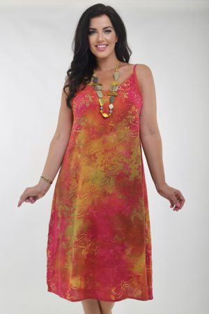 Model is wearing tie sundress in red and yellow by Angel Circle