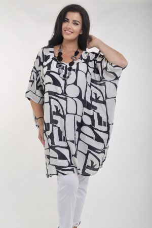 Woman wearing Antibes box tunic in black and stone by Orientique