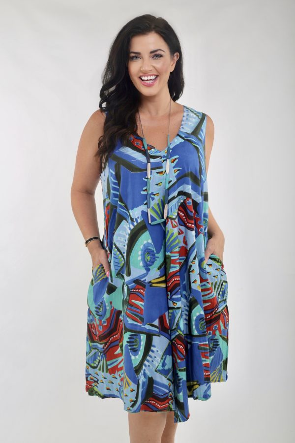 Woman wearing reversible dress by Orientique called Granada in blue or green