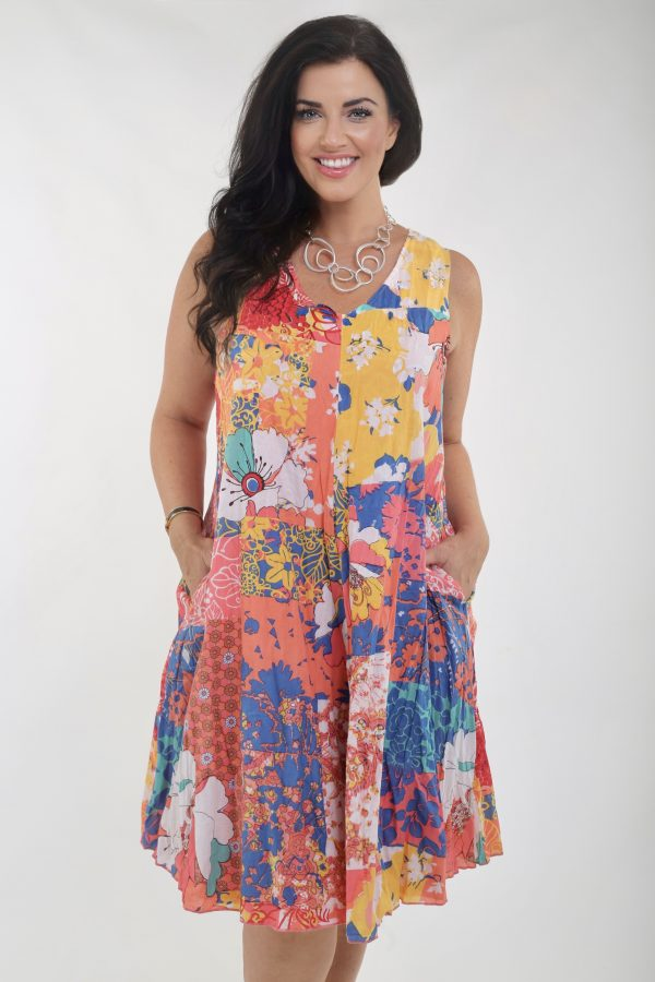 Modal is wearing a reversible dress in coral and multi colours called Pamplona by Orientique