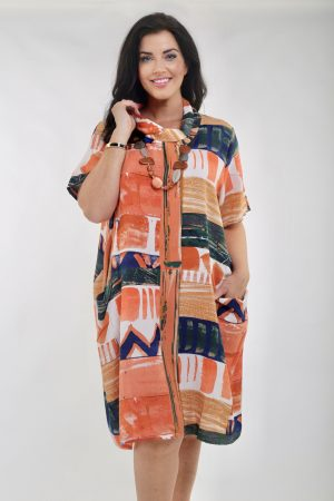 Model is wearing a tunic or a dress in papaya and navy colour called Zaragoza by Orientique