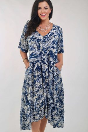 WOman is wearing Orientique Canary Islands dress in blue and cream.