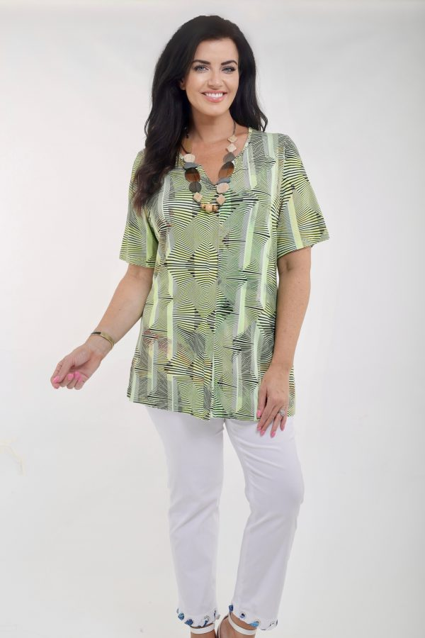 Woman wearing bright pistachio jersey tee by See You Biggi M